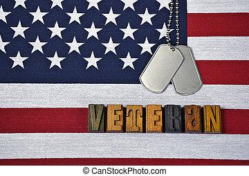 veteran dog tags on flag - word veteran in wooden...