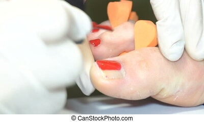 specialist beauty salon applying Polish nails to women...