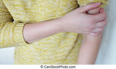a huge bruise on the arm of a woman in yellow . violence...