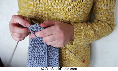 woman's hands knitting needles - female hands hold the yarn...