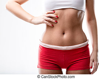 closeup of a good shaped woman's flat belly after or because...