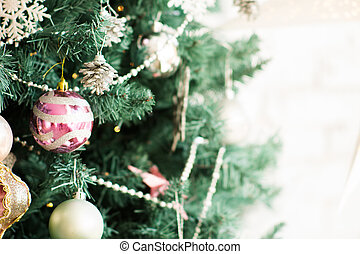 Fragment of a Christmas tree with ornaments