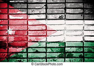 Jordanian flag painted on grunge wall