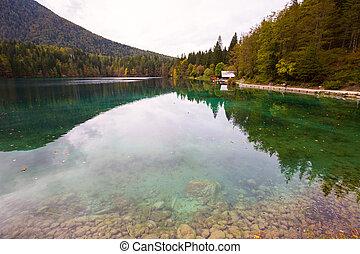Autumn scenery at lake Fusine mountain lake - Autumn scenery...