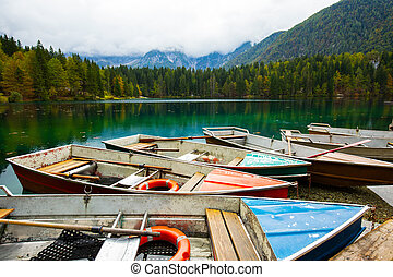 Alpine landscape and colorful boats, Lake Fusine,Italy -...