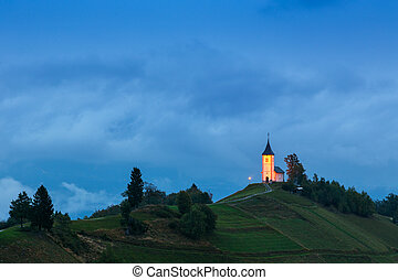 St. Primoz church on the hill at sunset at Jamnik, Slovenia