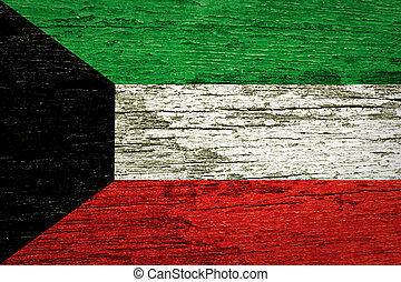 Kuwait flag painted on old wood texture