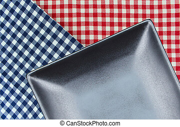 Top view plate on checkered tablecloth pattern background...
