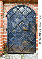 Old ornamental black metal door