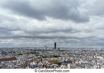 Montparnasse tower over Paris, cloudy day - Cloudy day with...