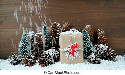 Christmas and New Year background with snow, pine cones,...
