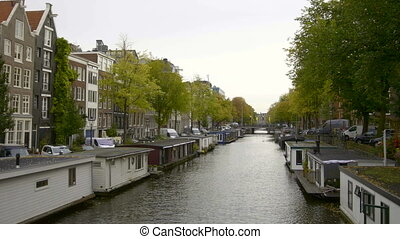 Vessels and houseboats along canals, Amsterdam, Netherlands