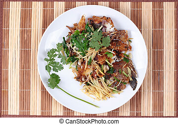 Thai food, Fried ginger with Tilapia fish (Call Pla Nil Pad...