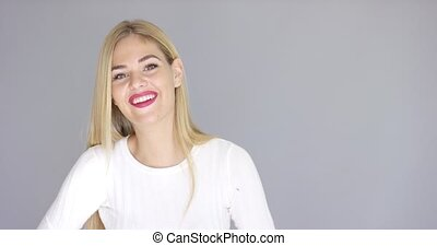 Attractive blond woman with a happy smile - Attractive young...