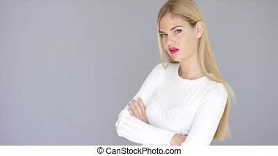 Self-assured young blond woman