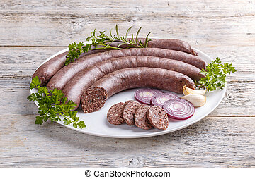 Tasty raw black pudding with onion