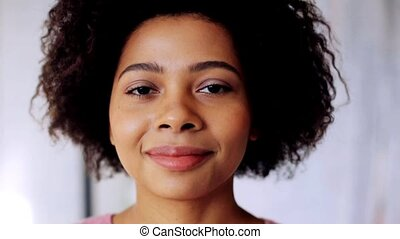 happy smiling african american young woman face - race,...