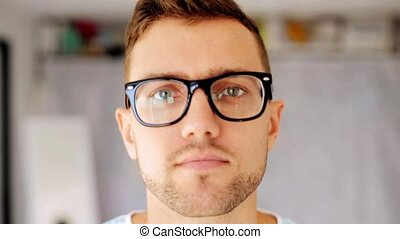happy smiling man in eyeglasses - emotion, expression,...