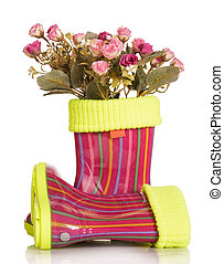 Children rubber boots with fabric inset and roses isolated....