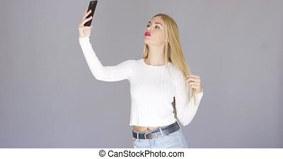 Fun sexy young woman posing for a selfie - Fun sexy young...