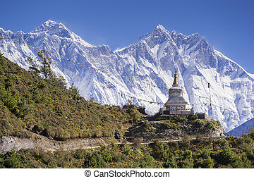 View of a Buddhist stupa with mountain Lhotse behind on the...