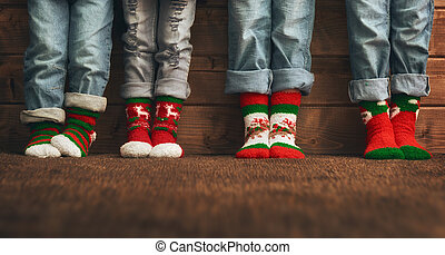 feet in socks with a Christmas ornament