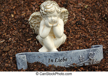 little angel sculpture decorate in small garden with a sign...
