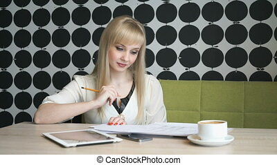 Girl writes important information in a diary - Blonde girl...