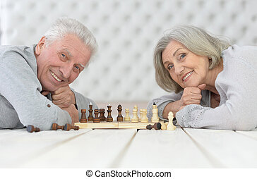 happy Senior couple playing chess