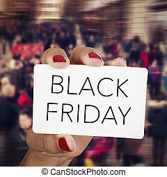 woman with a signboard with the text black friday - closeup...