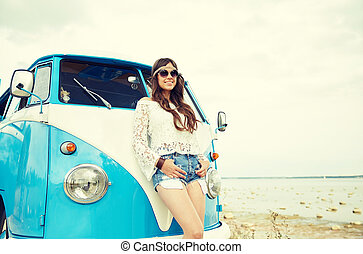 smiling young hippie woman with minivan car - summer...