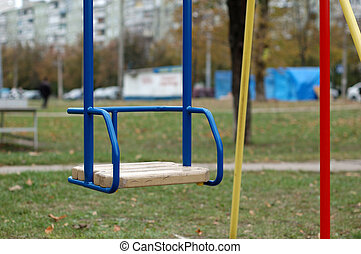 Children's swing blue color in the park.