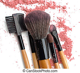makeup brushes and broken color eye shadows
