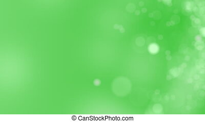 Abstract glowing bokeh circles or sparks - Green motion...