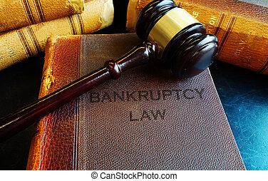 Gavel on bankruptcy Law books - Bankruptcy Law books with...