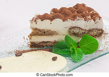 Slice of self-made italian tiramisu dessert served on a...