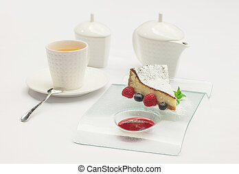Passion fruit cake, mousse dessert on a white plate with cup...