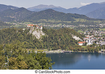 Castle and St. Martins Church overlooking Bled Lake in Slovenia.