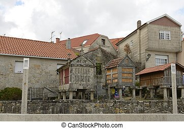 Houses and typical granaries in Combarro, a village of the...