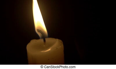 Candle in the wind in the night