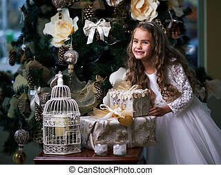 Beautiful toothless girl in white dress enjoys the gifts -...