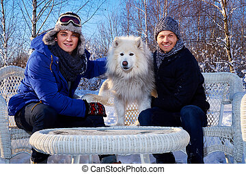 Two friends with dog spend winter holidays together at...
