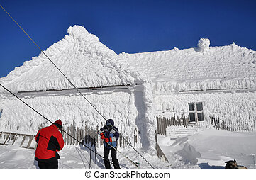 Ice covered house in the mountains - Ice covered house in...