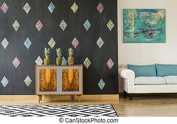Black and white wall in living room - Living room with black...