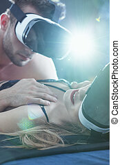 Lovers using virtual glasses during erotic intimate moments