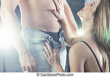 Erotic foreplay for attractive couple