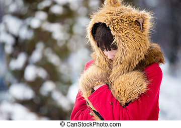 Female feeling cold outdoors in wintertime - Portrait of...