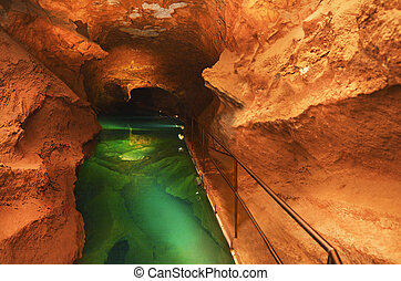 River Cave water pool Jenolan Caves Australia - Woman looks...