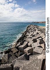 Concrete blocks in the jetty of Los Cristiano (Tenerife -...