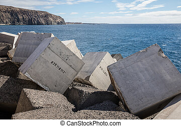 Concrete blocks numbered in the jetty of Los Cristiano...